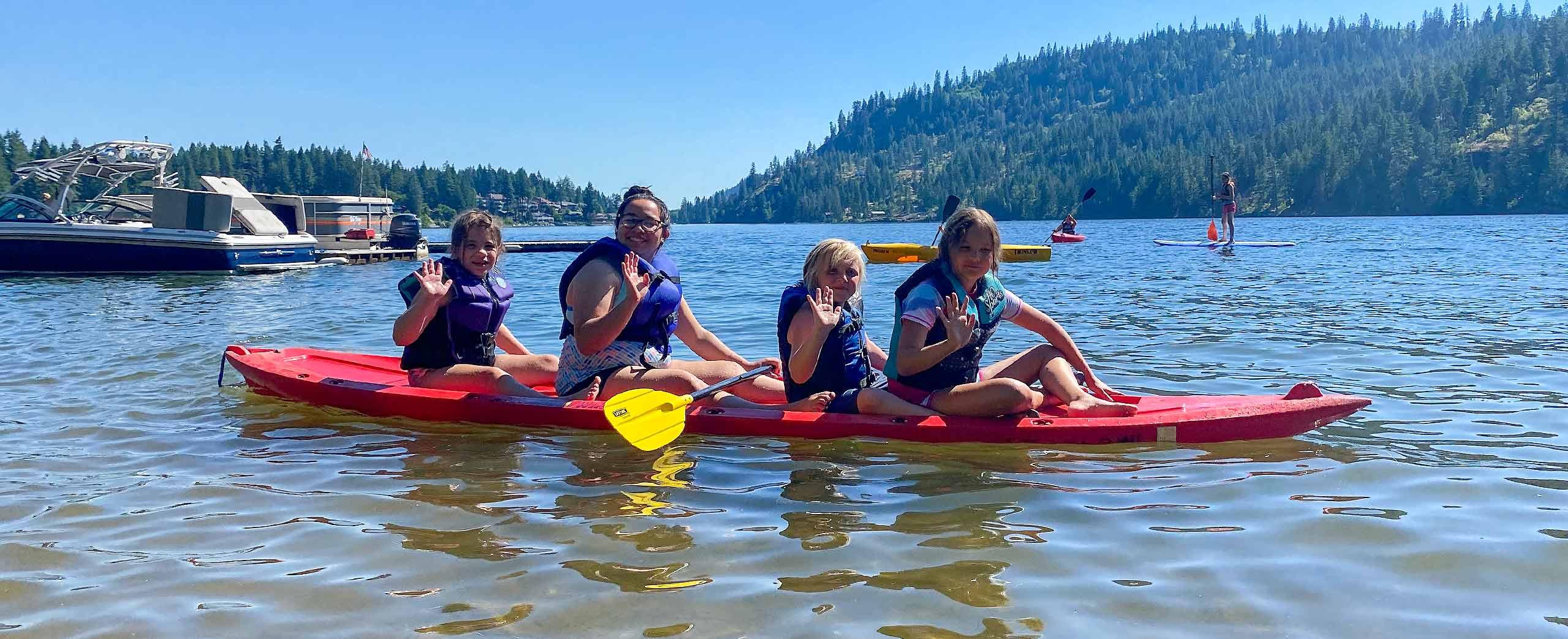 Kids playing on a kayak at Twinlow Camp
