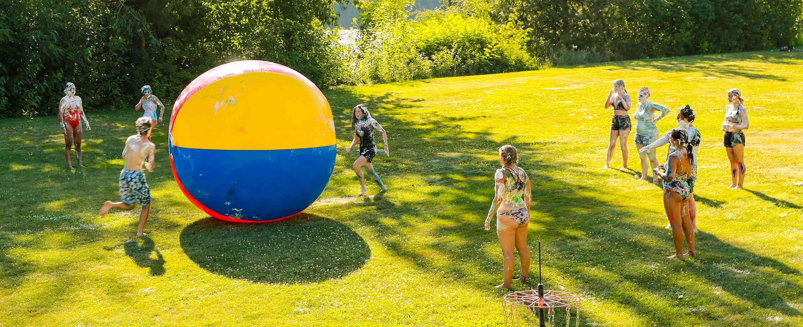 High school Camp kids playing with a 12 foot beach ball