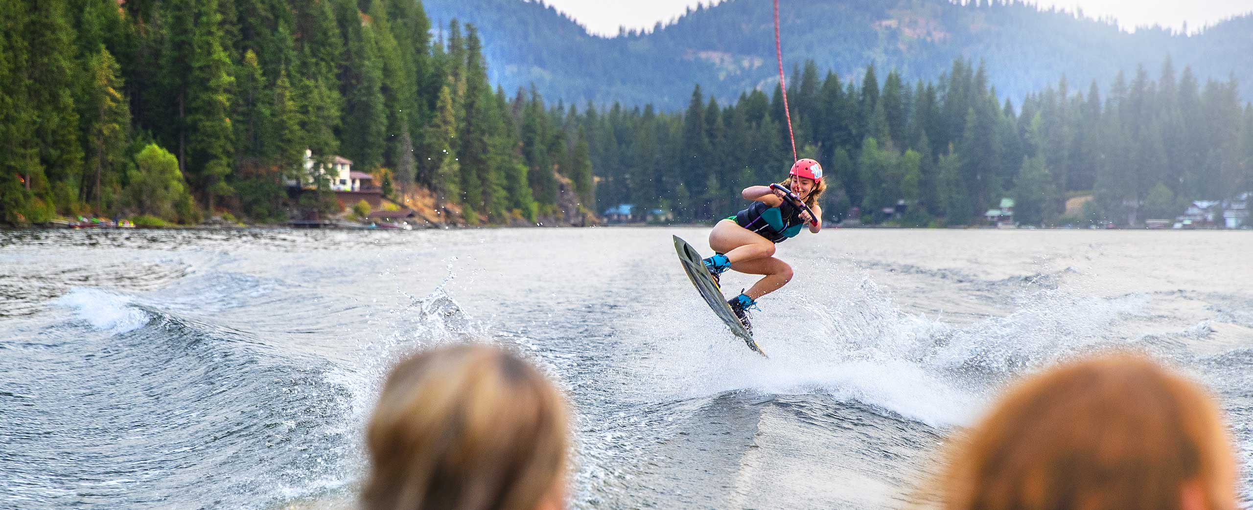 High school water sports camper jumping the wake