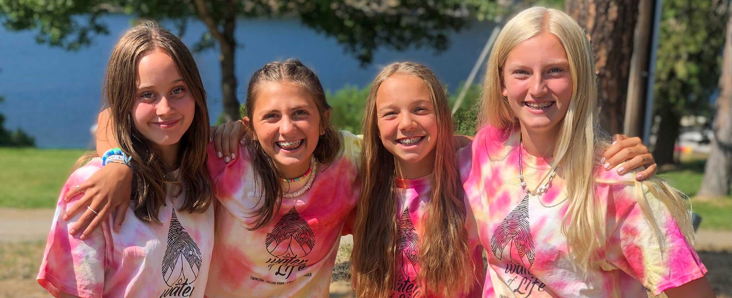 Four middle school campers smiling for the camera