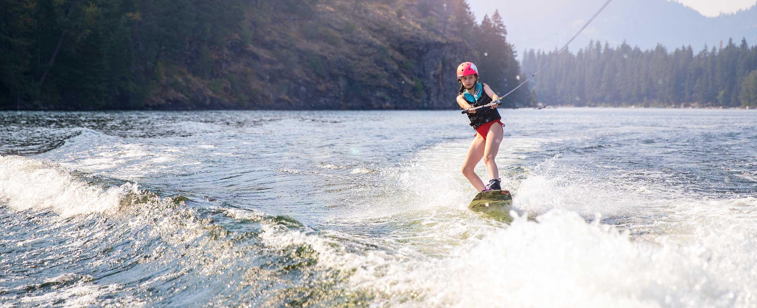 Middle school camper wakeboarding