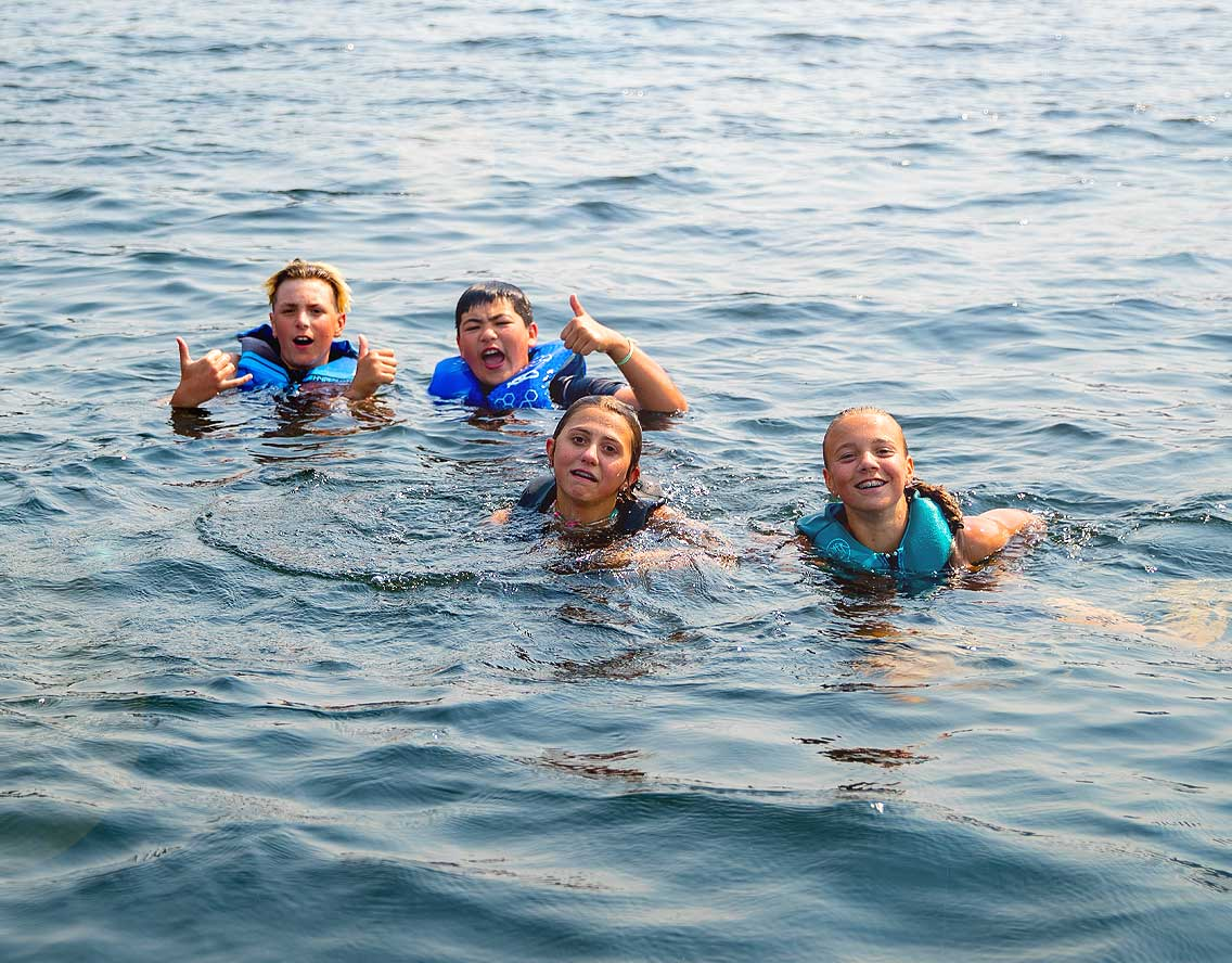 Middle school campers chilling in the lake